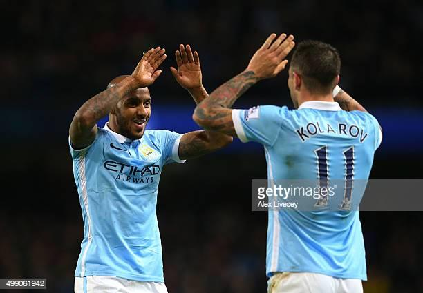 Aleksandar Kolarov of Manchester City celebrates scoring his team's third goal with his team mate Fabian Delph during the Barclays Premier League...