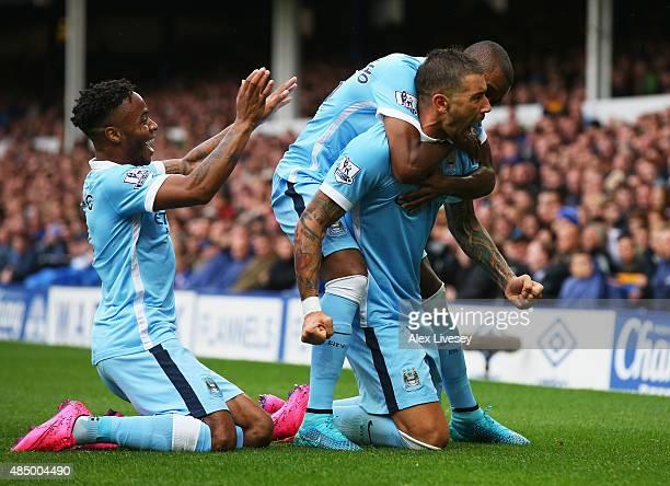 Aleksandar Kolarov of Manchester City celebrates scoring the opening goal with Raheem Sterling during the Barclays Premier League match between...