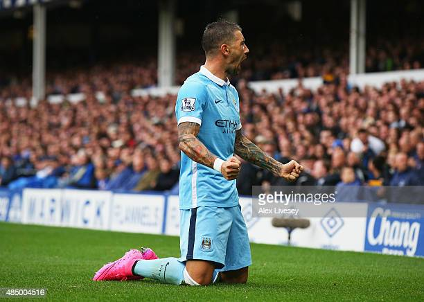 Aleksandar Kolarov of Manchester City celebrates scoring the opening goal during the Barclays Premier League match between Everton and Manchester...