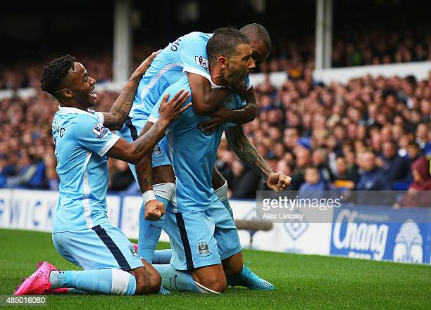 Aleksandar Kolarov of Manchester City celebrates scoring the opening goal with Raheem Sterling during the Barclays Premier League match between...