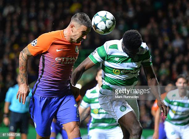 Aleksandar Kolarov of Manchester City challenges Kolo Toure of Celtic during the UEFA Champions League match between Celtic FC and Manchester City FC...