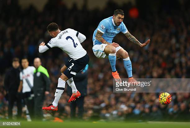 Aleksandar Kolarov of Manchester City charges down Kyle Walker of Tottenham Hotspur during the Barclays Premier League match between Manchester City...