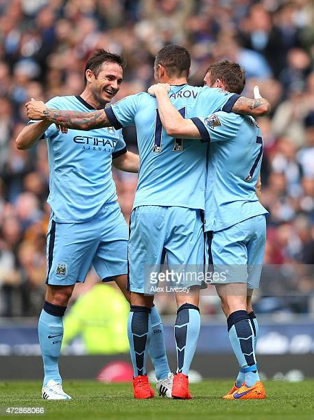 Aleksandar Kolarov of Manchester City is congratulated by teammates Frank Lampard of Manchester City and James Milner of Manchester City after...