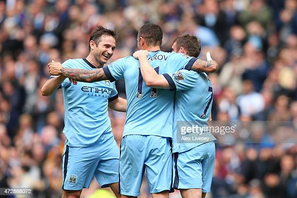 Aleksandar Kolarov of Manchester City is congratulated by teammates Frank Lampard of Manchester City and James Milner of Manchester City after...