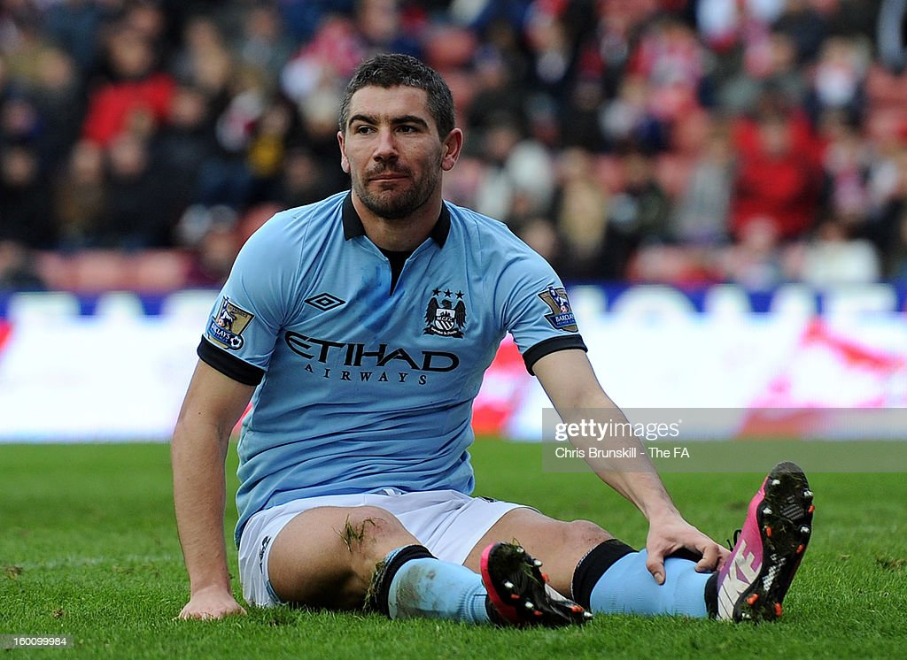 <a gi-track='captionPersonalityLinkClicked' href=/galleries/search?phrase=Aleksandar+Kolarov&family=editorial&specificpeople=4329824 ng-click='$event.stopPropagation()'>Aleksandar Kolarov</a> of Manchester City looks on during the FA Cup with Budweiser Fourth Round match between Stoke City and Manchester City at Britannia Stadium on January 26, 2013 in Stoke on Trent, England.