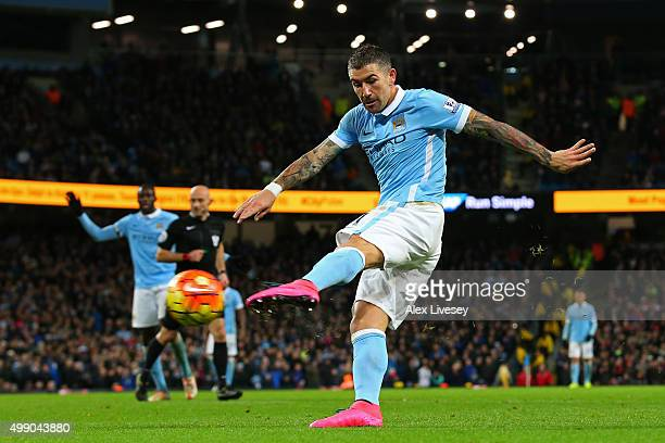 Aleksandar Kolarov of Manchester City scores his team's third goal during the Barclays Premier League match between Manchester City and Southampton...