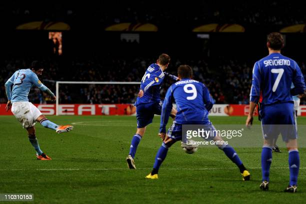 Aleksandar Kolarov of Manchester City scores the opening goal during the UEFA Europa League round of 16 second leg match between Manchester City and...