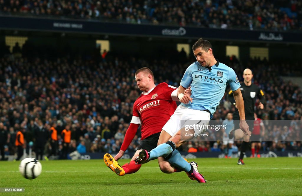 <a gi-track='captionPersonalityLinkClicked' href=/galleries/search?phrase=Aleksandar+Kolarov&family=editorial&specificpeople=4329824 ng-click='$event.stopPropagation()'>Aleksandar Kolarov</a> of Manchester City scores the second goal during the FA Cup sponsored by Budweiser sixth round match between Manchester City and Barnsley at Etihad Stadium on March 9, 2013 in Manchester, England.