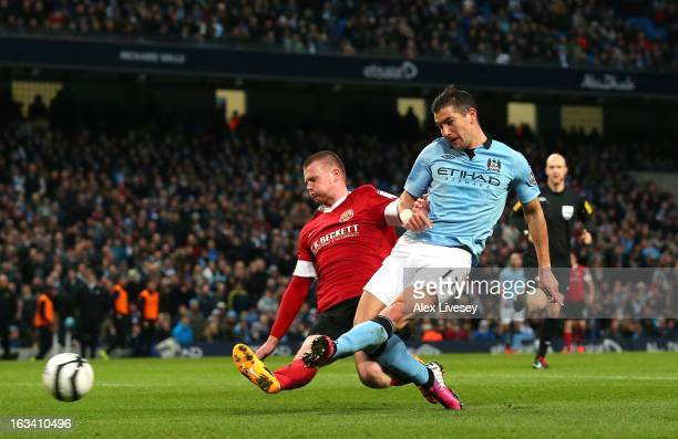 Aleksandar Kolarov of Manchester City scores the second goal during the FA Cup sponsored by Budweiser sixth round match between Manchester City and...