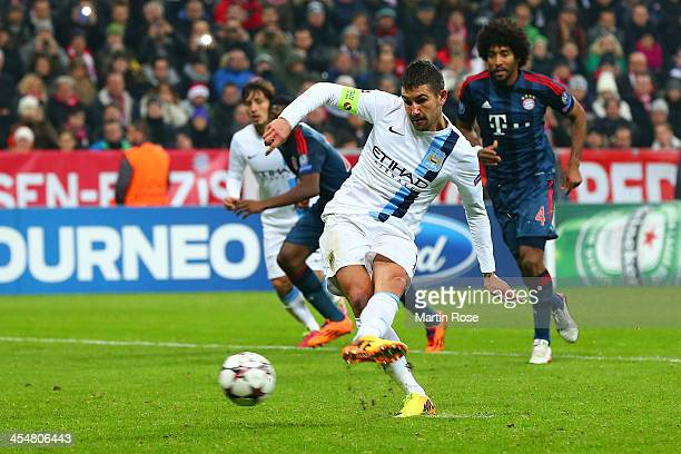 Aleksandar Kolarov of Manchester City scores their second goal from the penalty spot during the UEFA Champions League Group D match between FC Bayern...
