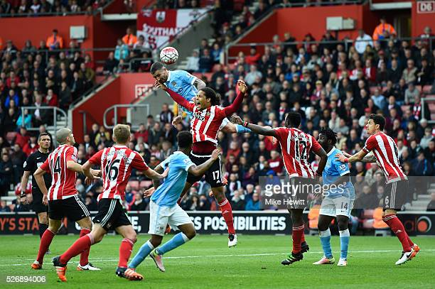 Aleksandar Kolarov of Manchester City wins a header from Virgil van Dijk of Southampton during the Barclays Premier League match between Southampton...