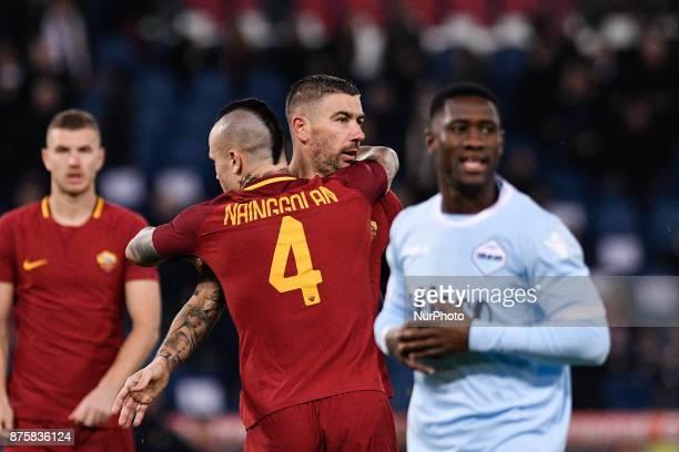 Aleksandar Kolarov of Roma and Radja Nainggolan of Roma during the Serie A match between Roma and Lazio at Olympic Stadium Roma Italy on 18 November...