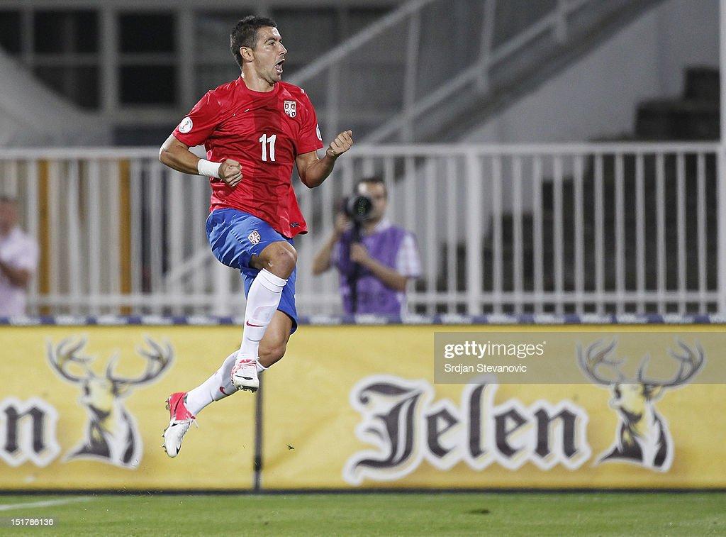 Aleksandar Kolarov of Serbia celebrates scoring a goal during the FIFA 2014 World Cup Qualifier at stadium Karadjordje Park between Serbia and Wales on September 11, 2012 in Novi Sad, Serbia