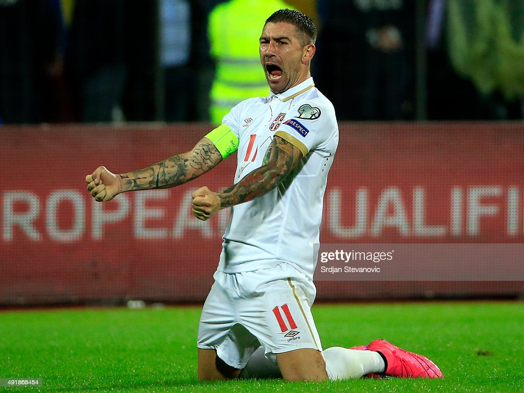 Aleksandar Kolarov of Serbia celebrates victory after the UEFA EURO 2016 qualifier between Albania and Serbia at the Elbasan Arena on October 08 2015...