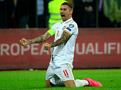 Aleksandar Kolarov of Serbia celebrates victory after the UEFA EURO 2016 qualifier between Albania and Serbia at the Elbasan Arena on October 08 2015...