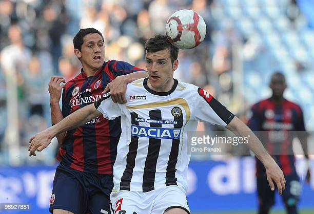 Aleksandar Lukovic of Udinese competes with Henry Damian Gimenez of Bologna during the Serie A match between Udinese Calcio and Bologna FC at Stadio...