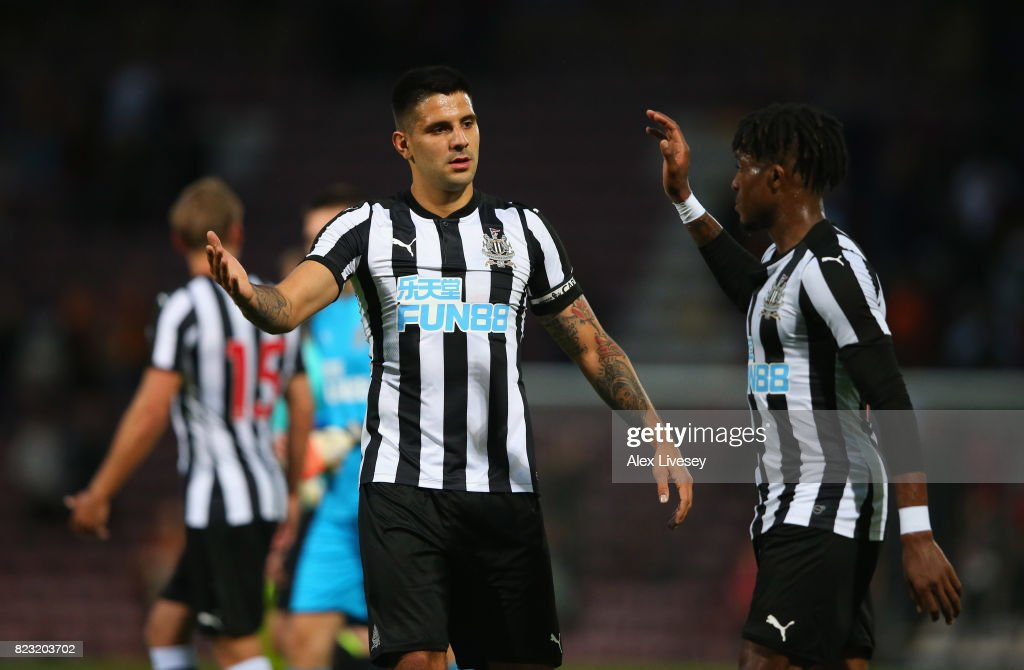 Aleksandar Mitrovic and Rolando Aarons of Newcastle United celebrate after a pre-season friendly match between Bradford City and Newcastle United at Northern Commercials Stadium on July 26, 2017 in Bradford, England.