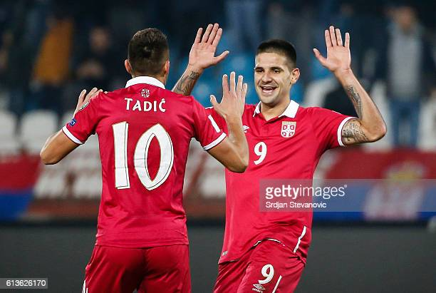 Aleksandar Mitrovic celebrate scoring a goal with the Dusan Tadic of Serbia during the FIFA 2018 World Cup Qualifier between Serbia and Austria at...
