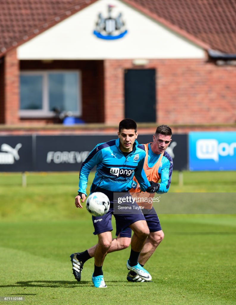 Aleksandar Mitrovic (L) controls the ball whilst Ciaran Clark looks to challenge during the Newcastle United Training Session at the Newcastle United Training Ground on April 21, 2017 in Newcastle upon Tyne, England.