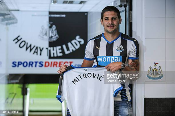 Aleksandar Mitrovic holds a Newcastle United Shirt in the tunnel at StJames' Park after signing for the club on July 20 in Newcastle upon Tyne England