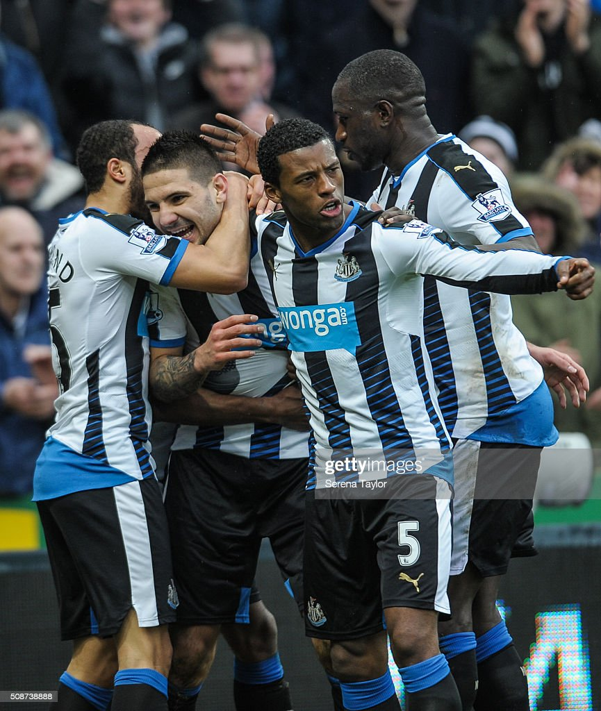 Aleksandar Mitrovic (second from left) of Newcastle (45) celebrates with teammates <a gi-track='captionPersonalityLinkClicked' href=/galleries/search?phrase=Andros+Townsend&family=editorial&specificpeople=4266573 ng-click='$event.stopPropagation()'>Andros Townsend</a> (L) <a gi-track='captionPersonalityLinkClicked' href=/galleries/search?phrase=Georginio+Wijnaldum&family=editorial&specificpeople=2146603 ng-click='$event.stopPropagation()'>Georginio Wijnaldum</a> (second from right) and <a gi-track='captionPersonalityLinkClicked' href=/galleries/search?phrase=Moussa+Sissoko&family=editorial&specificpeople=4191251 ng-click='$event.stopPropagation()'>Moussa Sissoko</a> (R) after scoring the opening goal during the Barclays Premier League match between Newcastle United and West Bromwich Albion at St.James' Park on February 6, 2016, in Newcastle upon Tyne, England.