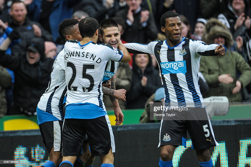 Aleksandar Mitrovic (c) of Newcastle celebrates with teammates <a gi-track='captionPersonalityLinkClicked' href=/galleries/search?phrase=Andros+Townsend&family=editorial&specificpeople=4266573 ng-click='$event.stopPropagation()'>Andros Townsend</a> (L) and <a gi-track='captionPersonalityLinkClicked' href=/galleries/search?phrase=Georginio+Wijnaldum&family=editorial&specificpeople=2146603 ng-click='$event.stopPropagation()'>Georginio Wijnaldum</a> (R) after scoring the opening goal during the Barclays Premier League match between Newcastle United and West Bromwich Albion at St.James' Park on February 6, 2016, in Newcastle upon Tyne, England.