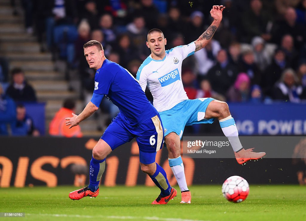 Aleksandar Mitrovic of Newcastle United beats Robert Huth of Leicester City during the Barclays Premier League match between Leicester City and Newcastle United at The King Power Stadium on March 14, 2016 in Leicester, England.