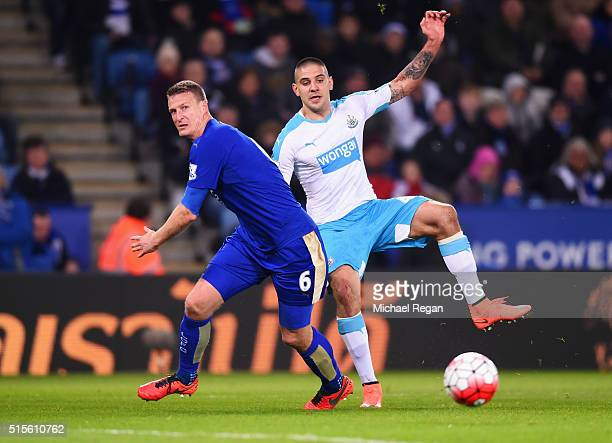 Aleksandar Mitrovic of Newcastle United beats Robert Huth of Leicester City during the Barclays Premier League match between Leicester City and...