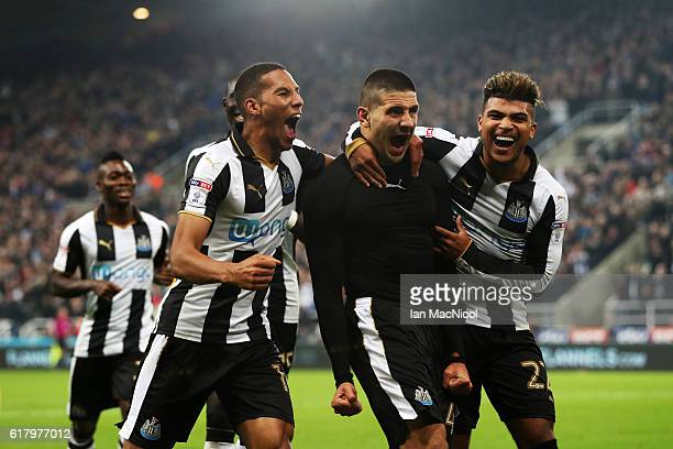 Aleksandar Mitrovic of Newcastle United celebrates scoring his sides fourth goal with his team mates during the EFL Cup fourth round match between...