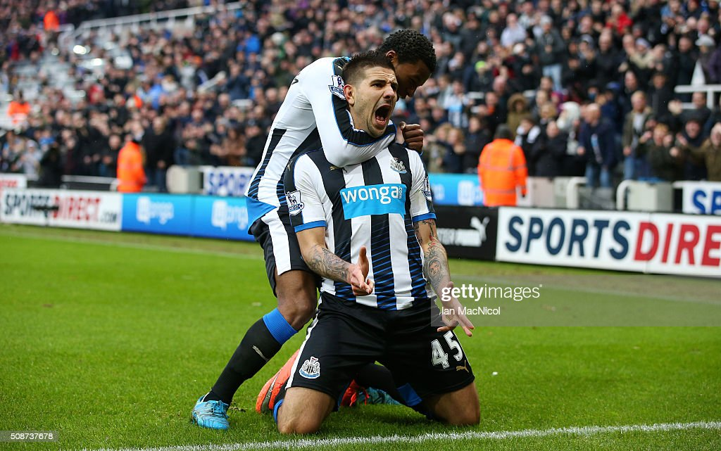 Aleksandar Mitrovic (R) of Newcastle United celebrates scoring his team's first goal with his team mate <a gi-track='captionPersonalityLinkClicked' href=/galleries/search?phrase=Georginio+Wijnaldum&family=editorial&specificpeople=2146603 ng-click='$event.stopPropagation()'>Georginio Wijnaldum</a> (L) during the Barclays Premier League match between Newcastle United and West Bromwich Albion at St James' Park on February 6, 2016 in Newcastle upon Tyne, England.
