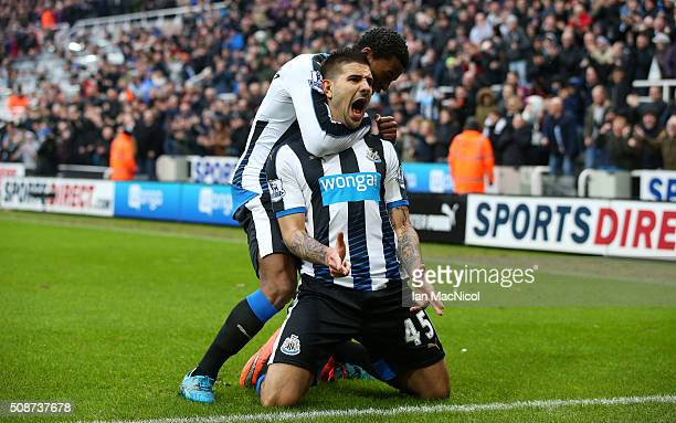 Aleksandar Mitrovic of Newcastle United celebrates scoring his team's first goal with his team mate Georginio Wijnaldum during the Barclays Premier...