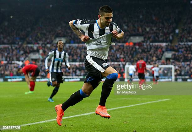 Aleksandar Mitrovic of Newcastle United celebrates scoring his team's first goal during the Barclays Premier League match between Newcastle United...