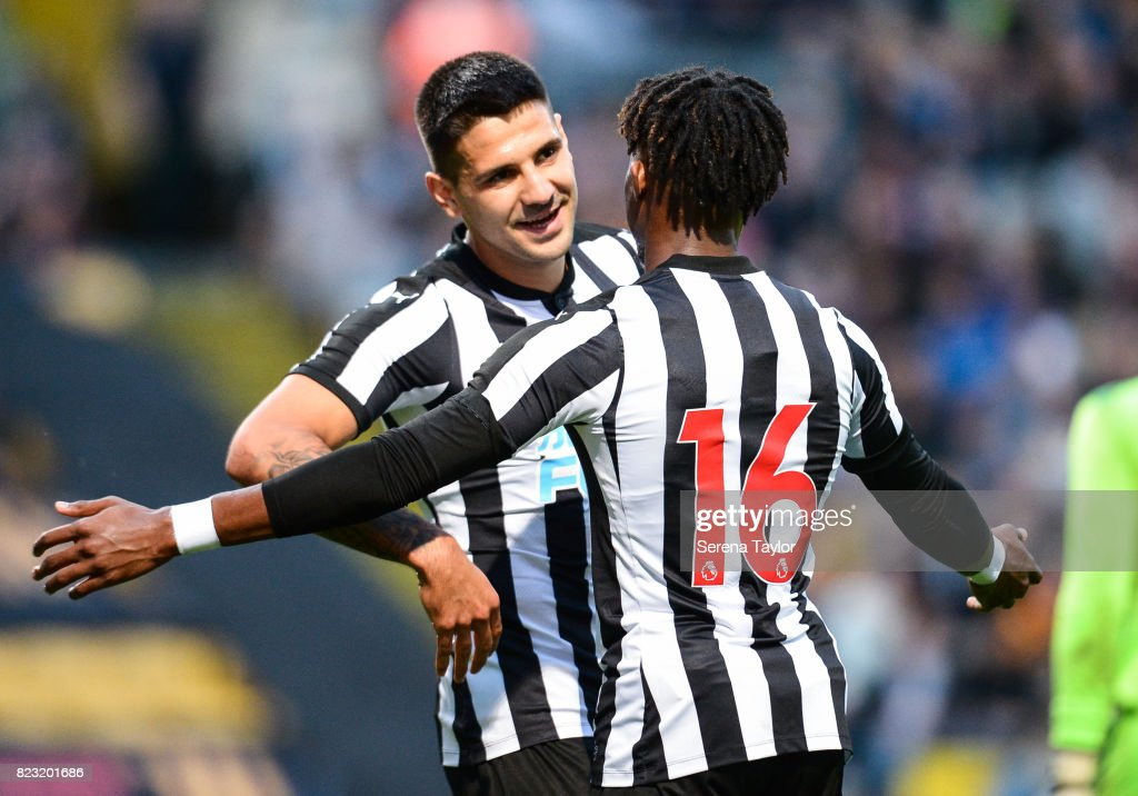 Aleksandar Mitrovic of Newcastle United (L) celebrates with teammate Rolando Aarons (R) after scoring Newcastle's third goal during the the Pre Season Friendly between Bradford City and Newcastle United at the Northern Commercials Stadium on July 26, 2017, in Bradford, England.