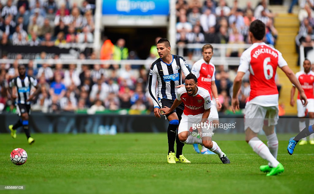 Aleksandar Mitrovic of Newcastle United fouls Francis Coquelin of Arsenal resulting in the red card during the Barclays Premier League match between...