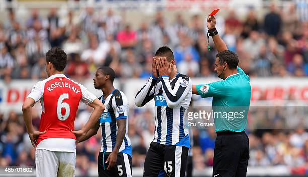 Aleksandar Mitrovic of Newcastle United is shown a red card by referee Andre Marriner during the Barclays Premier League match between Newcastle...