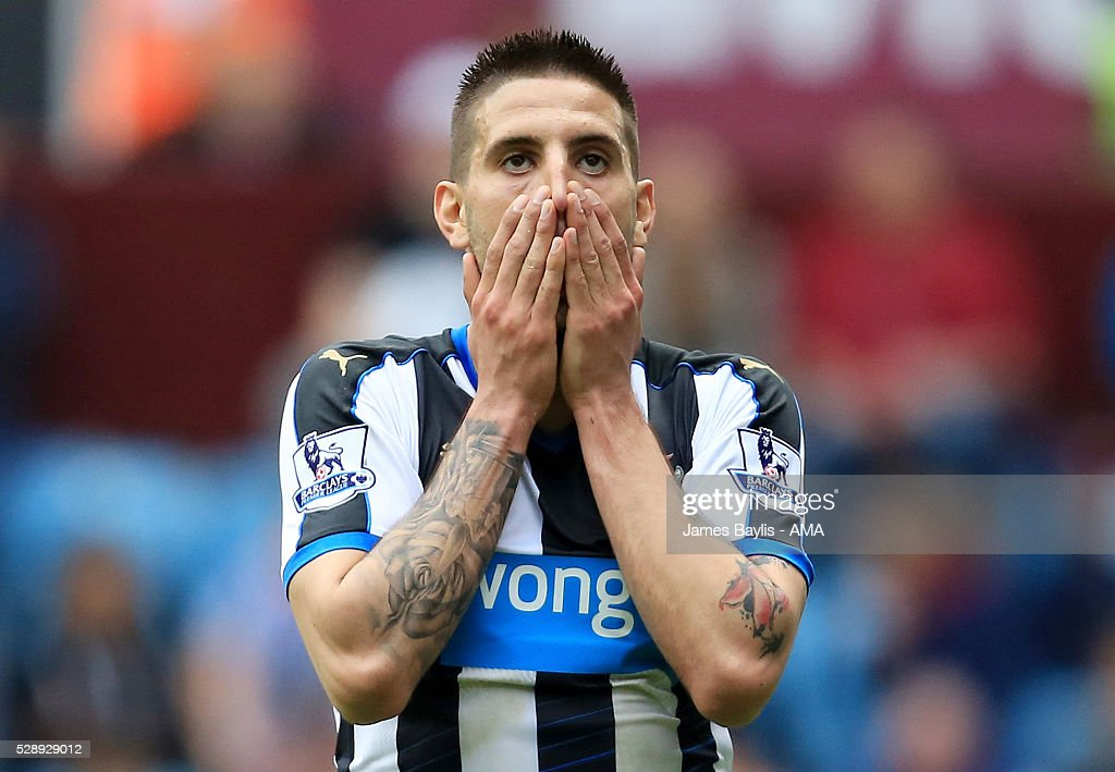 Aleksandar Mitrovic of Newcastle United reacts after missing a chance to score during the Barclays Premier League match between Aston Villa and Newcastle United at Villa Park on May 7, 2016 in Birmingham, United Kingdom.