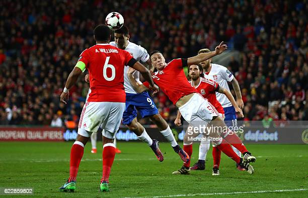 Aleksandar Mitrovic of Serbia scores his team's first goal during the FIFA 2018 World Cup Qualifier between Wales and Serbia at Cardiff City Stadium...