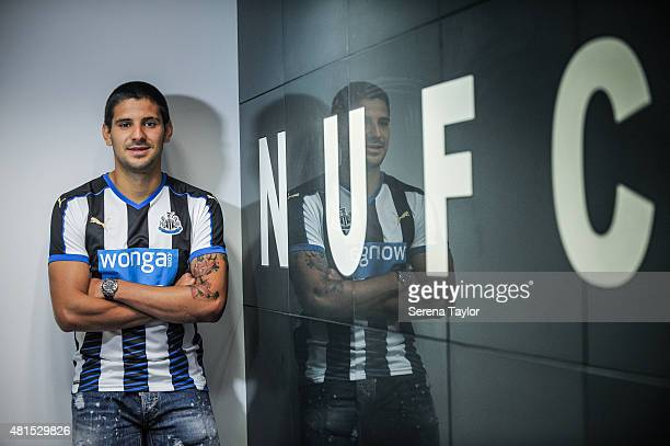 Aleksandar Mitrovic poses for photos with a NUFC sign in the dressing room at StJames' park after signing for the club on July 20 in Newcastle upon...