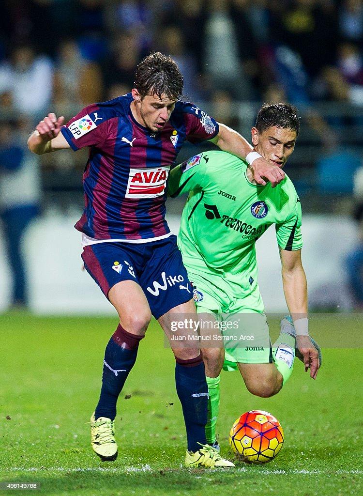 Aleksandar Pantic of SD Eibar duels for the ball with Emiliano Velazquez of Getafe CF during the La Liga match between SD Eibar and Getafe CF at Ipurua Municipal Stadium on November 7, 2015 in Eibar, Spain.