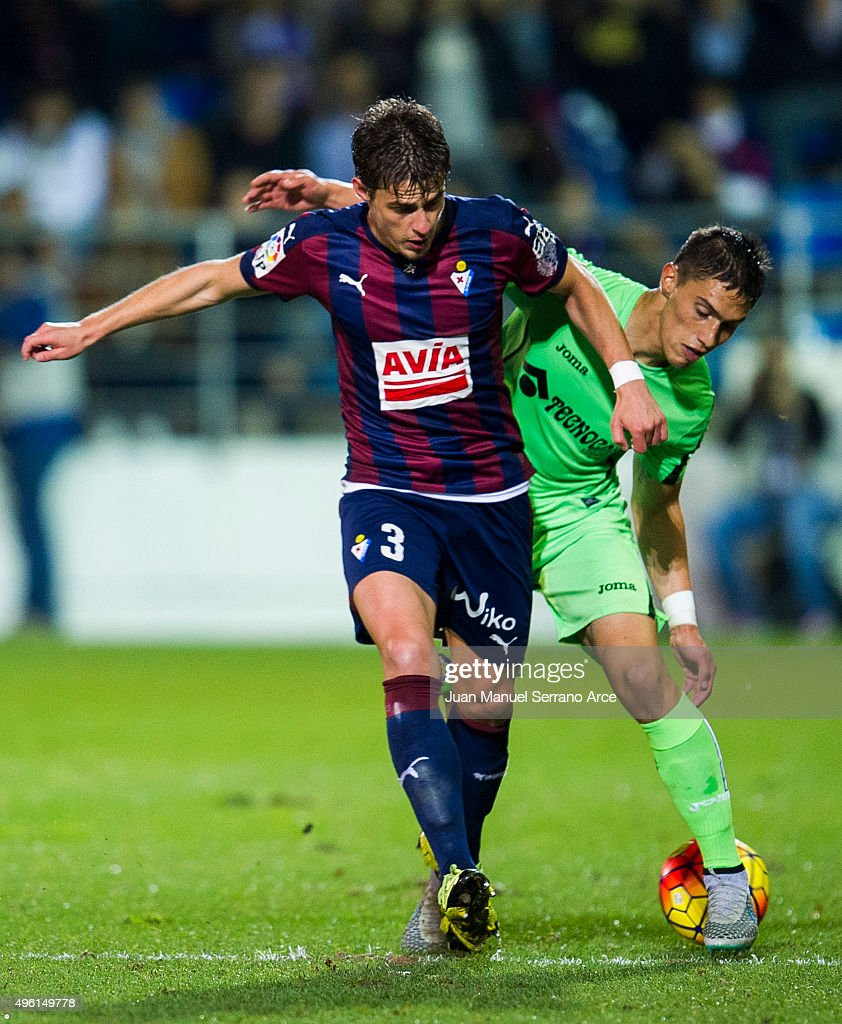 Aleksandar Pantic of SD Eibar duels for the ball with Emiliano Velazquez of Getafe CF during the La Liga match between SD Eibar and Getafe CF at Ipurua Municipal Stadium on November 7, 2015 in Eibar, Spain.