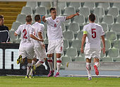 Aleksandar Pesic of Serbia celebrates after scoring the opening goal during the 2015 UEFA European U21 Championships Qualifier match between Italy...