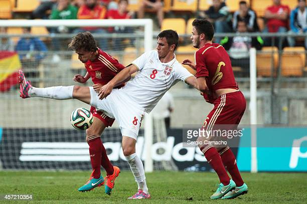 Aleksandar Pesic of Serbia duels for the ball with Sergi Roberto Carnicer and Saul Niguez of Spain the 2015 UEFA European Under21 Championship...