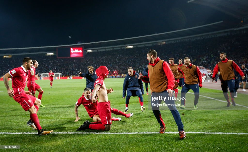 Aleksandar Prijovic (C) of Serbia celebrates scoring a goal with the team mates during the FIFA 2018 World Cup Qualifier between Serbia and Georgia at stadium Rajko Mitic on October 9, 2017 in Belgrade.