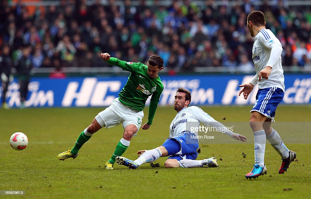 Aleksandar Stevanovic (L) of Bremen and Christian Fuchs (R) of Schalke battle for the ball during the Bundesliga match between Werder Bremen and FC Schalke 04 at Weser Stadium on April 6, 2013 in Bremen, Germany.