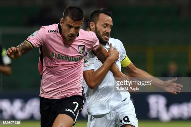 Aleksandar Trajkovski of Palermo and Claudio Terzi of Spezia fight during the Serie B match between US Citta di Palermo and AC Spezia at Stadio Renzo...