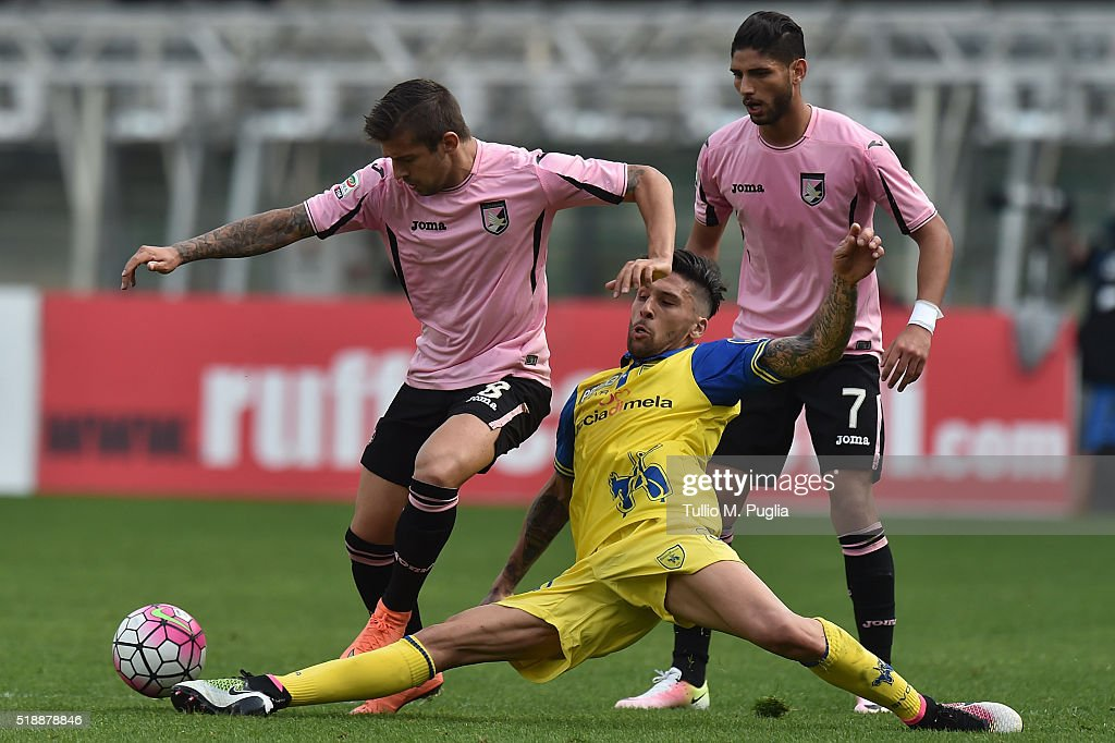 Aleksandar Trajkovski of Palermo and Lucas Castro of Chievo Verona compete for the ball during the Serie A match between AC Chievo Verona and US...