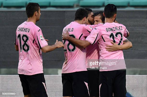 Aleksandar Trajkovski of Palermo celebrates with team mates after scoring his team's fourth goal during the Serie A match between US Citta di Palermo...