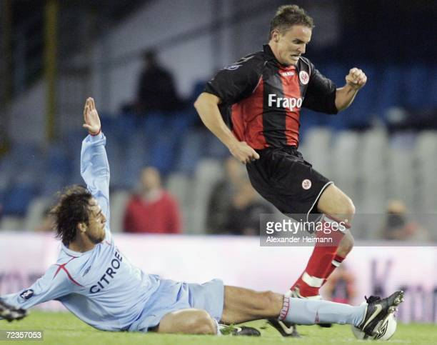 Aleksandar Vasoski of Frankfurt competes with Matias Lequi of Vigo during the UEFA Cup group H match between Celta Vigo and Eintracht Frankfurt at...