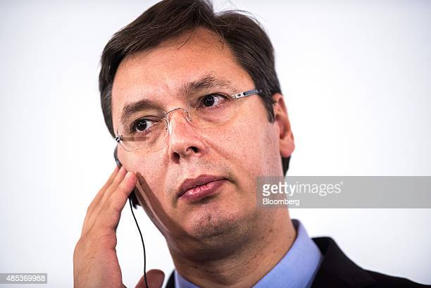 Aleksandar Vucic Serbia's prime minister listens to his earpiece during a news conference at the Western Balkans Summit in Vienna Austria on Thursday...