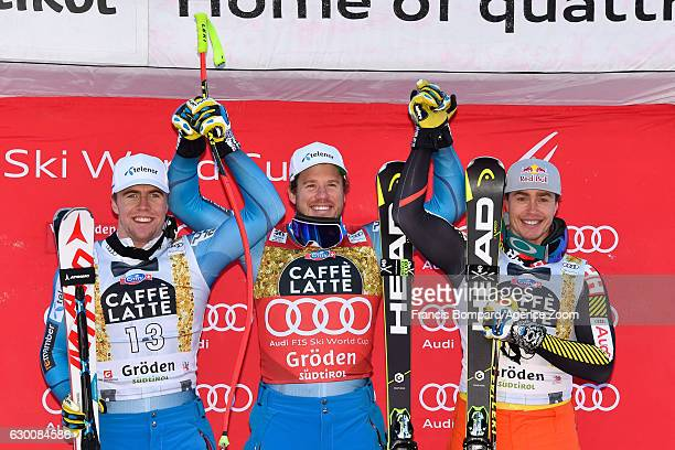 Aleksander Aamodt Kilde of Norway takes 2nd place Kjetil Jansrud of Norway takes 1st place Erik Guay of Canada takes 3rd place during the Audi FIS...